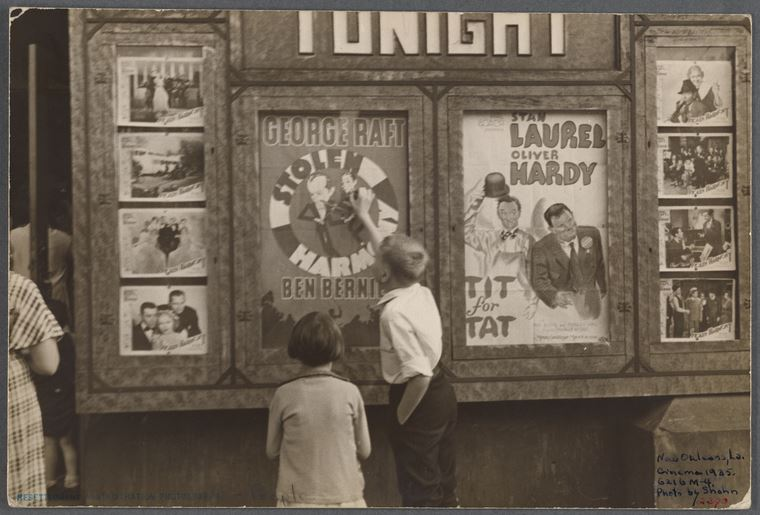 vintage black and white photo of children standing outside a movie theater