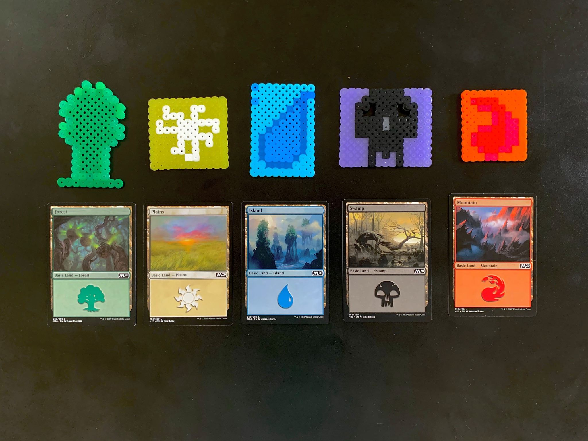Small Magic the Gathering icons created with colorful perler beads.